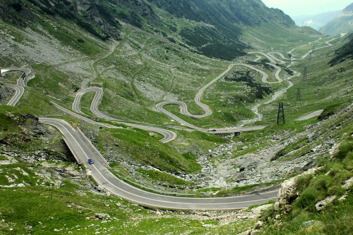 Transfăgărășan Road, Romania. .. Before anyone says anything, yes, both the words 'Trans' and 'Fag' are in the name.